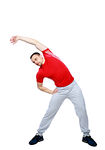 Sports man doing physical exercise for stretching over white background