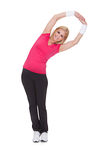Portrait Of Happy Woman Doing Stretching Exercise